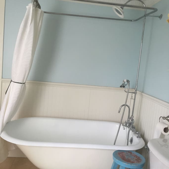 Claw foot tub and shower combination.