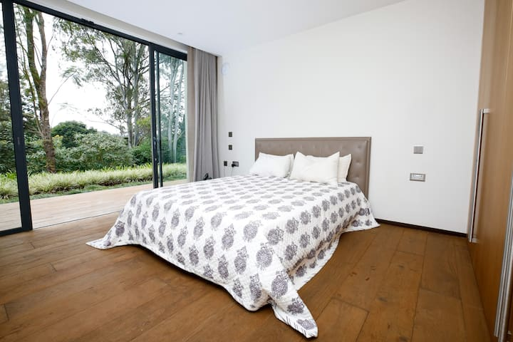 Comfortable mattress, high quality bed linens and beautiful forest view.