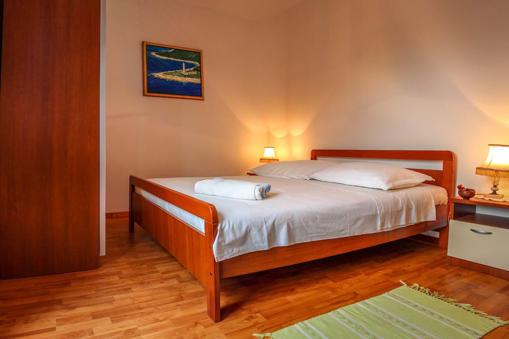 Comfortable first bedroom with private bathroom and balcony