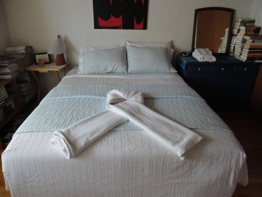 A queen size bed with fresh clean linens