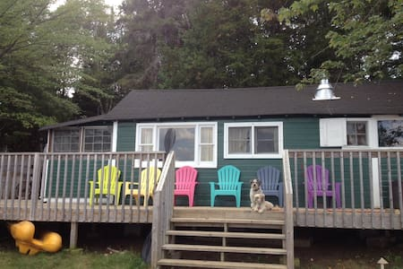 cottage with large wrap around deck.