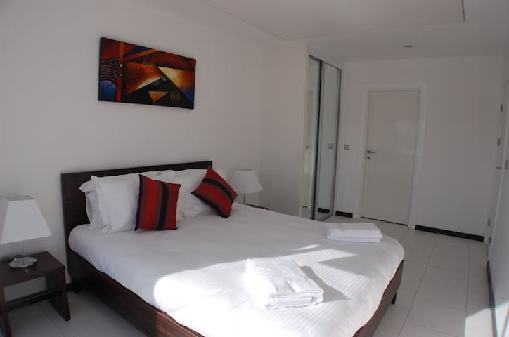 Bedroom n*1 -Very comfortable Queen size bed complete with fully fitted wardrobes and full height patio doors which open onto the private garden.
