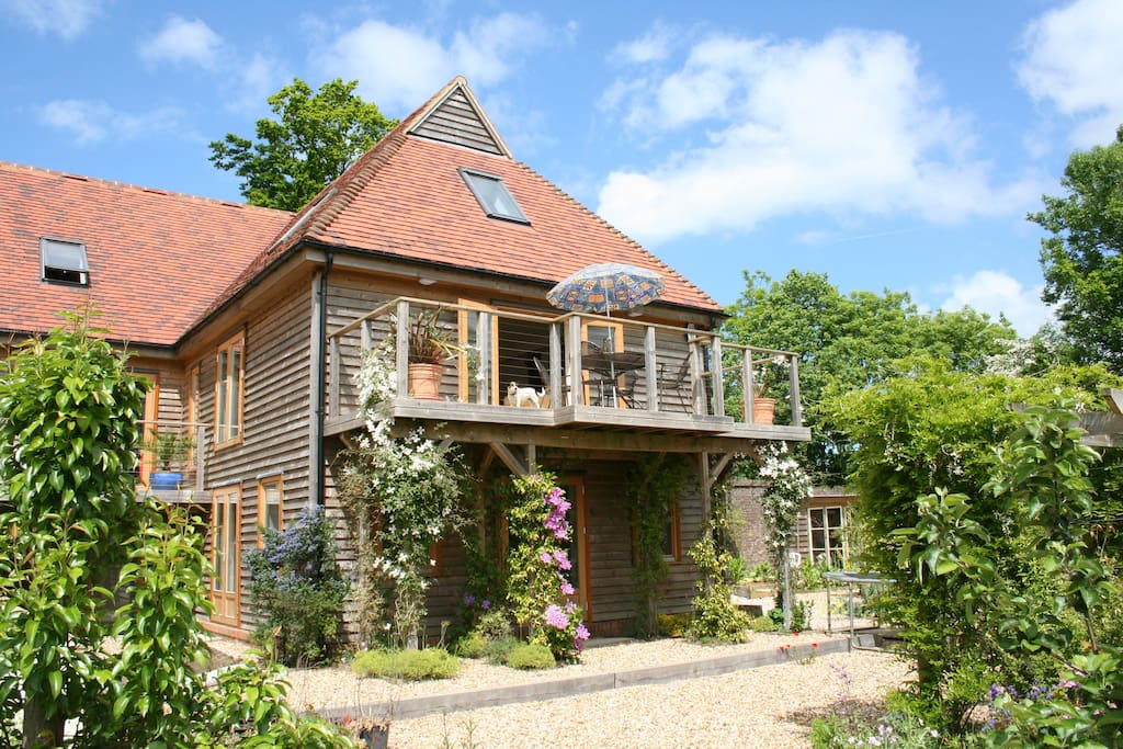 Enjoy far reaching views from the walled garden across to the Sussex countryside beyond.