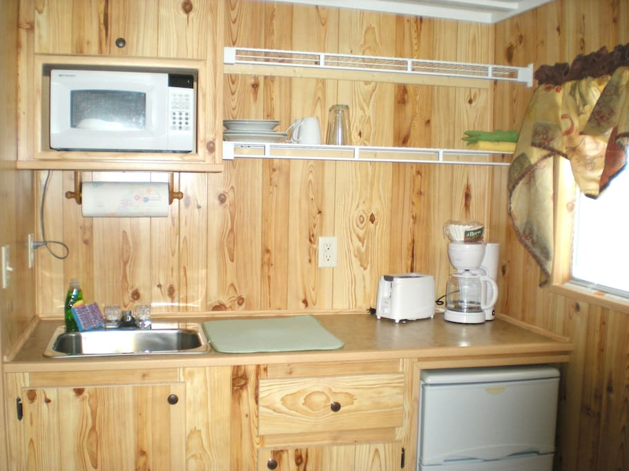 awesome kitchenette! complete with coffee pot, mini fridge, microwave, and a few dishes!