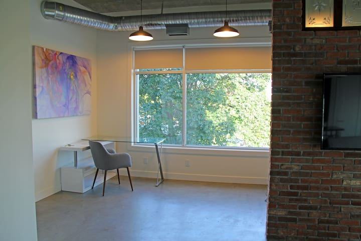 Office space with desk and chair for your workstation away from the office. WIFI throughout the space.