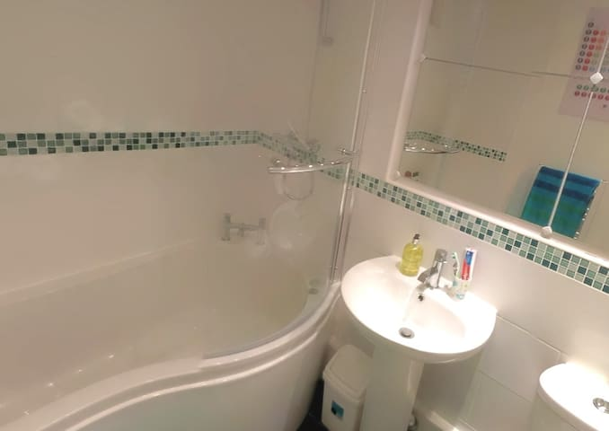 Your private family bathroom on 1st floor with bath & shower over (for guests only)