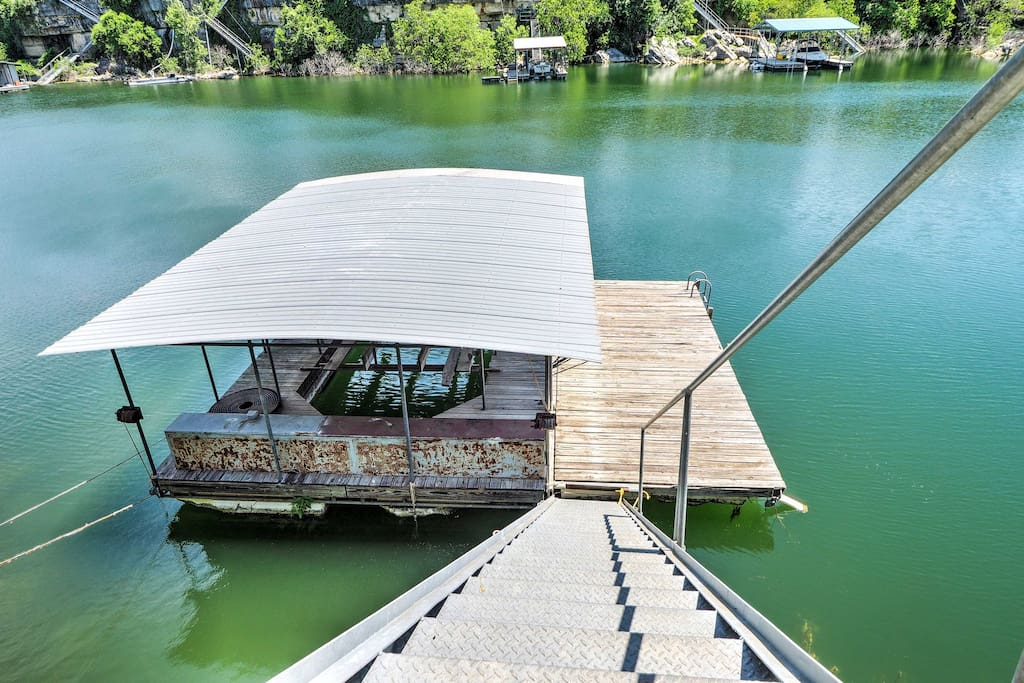 The lakefront home features a private boat dock nestled in the quiet cove.