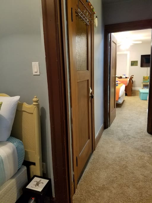 This photo shows the hall between the 2 rooms. The 1/2 bath is in the hallway. You have the entire top floor with private entrance.