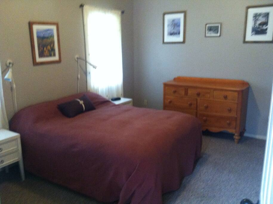 Queen size bed sleeps 2. Dresser and closet for clothing storage. Night stands with alarm clock and reading lights.