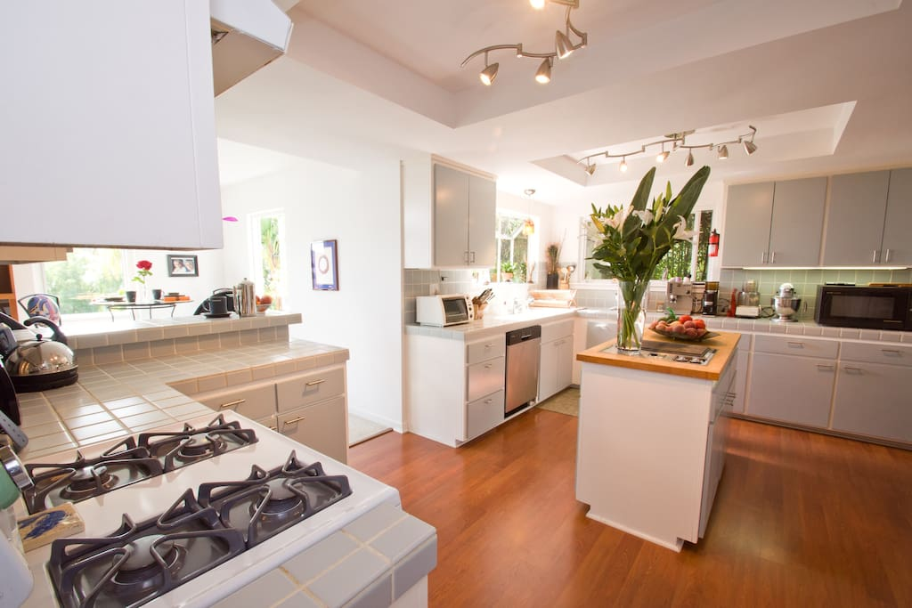 The sunny kitchen is well equipped with everything you need to feed 8 people, includes a counter top vented barbeque,dishwasher, new  fridge