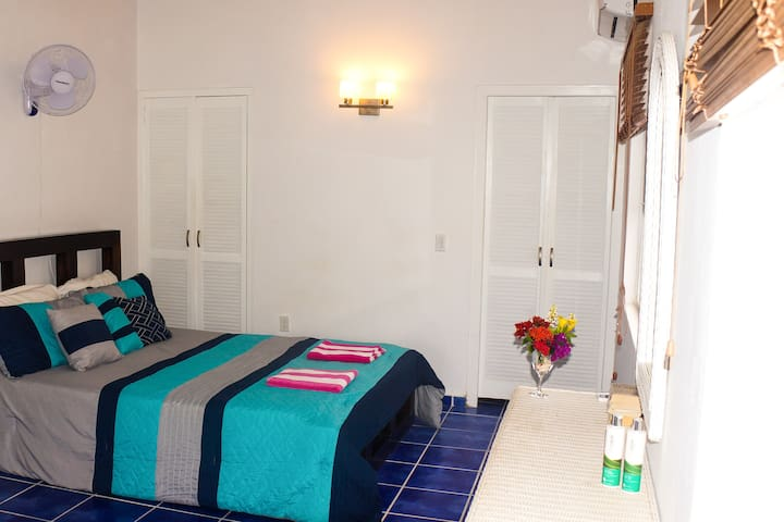 The comfortable queen size bed and air conditioned room provide great sleep.