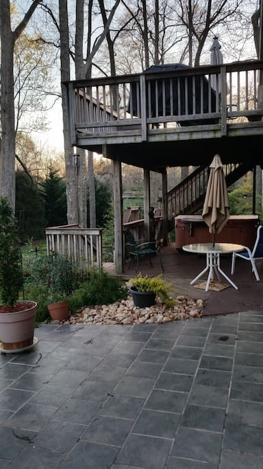 Private patio with table and grill.