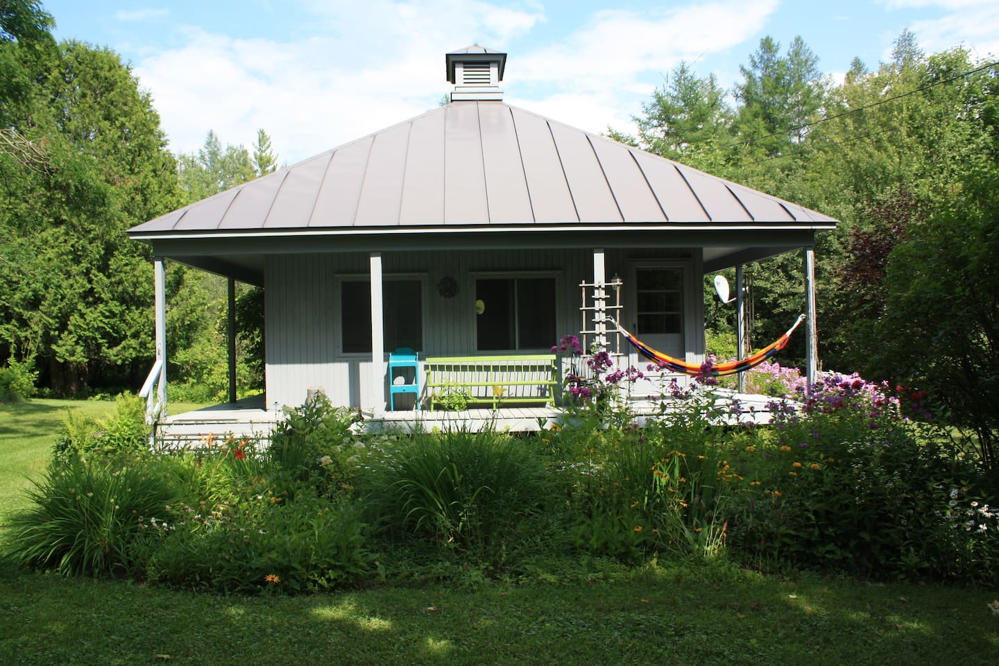 Front of the cottage in the summer.