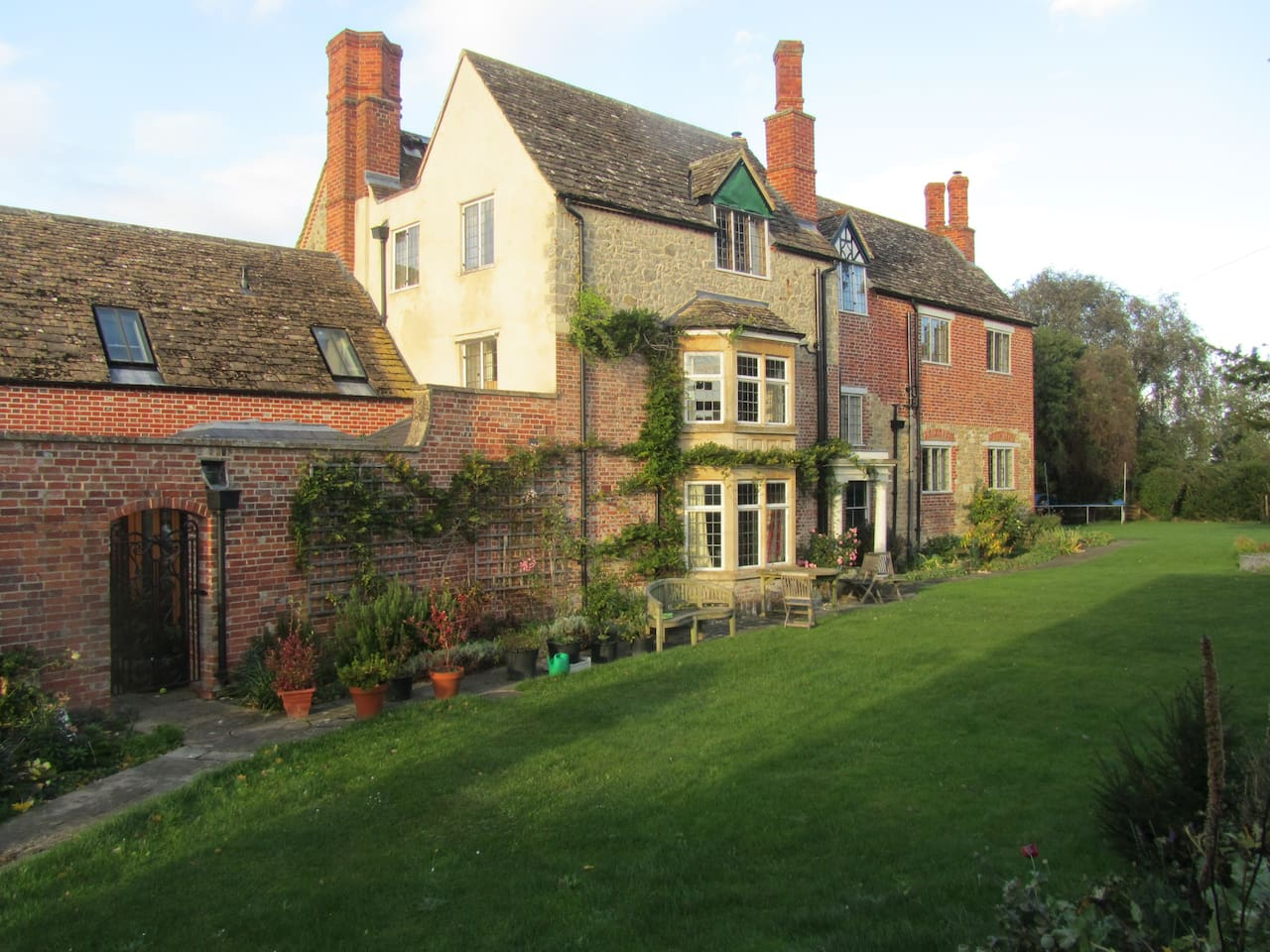 Charming southern face of the house which has a view of the 12th century church