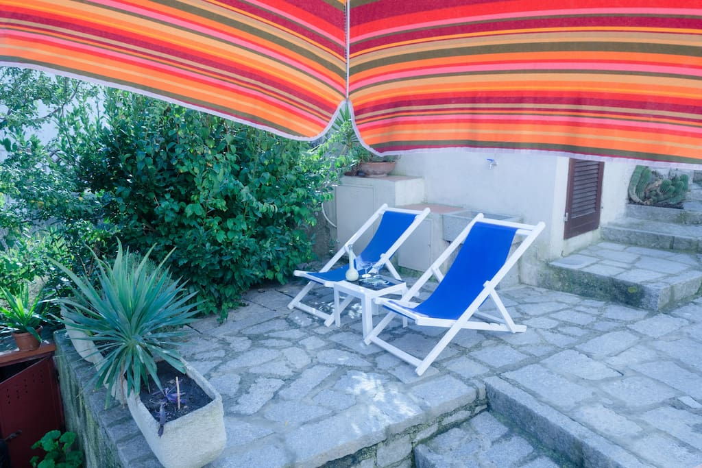 relaxing chairs and ombrella