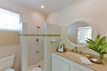 The master bathroom is stocked with fresh towels, soaps and a starter supply of bathroom tissue.
