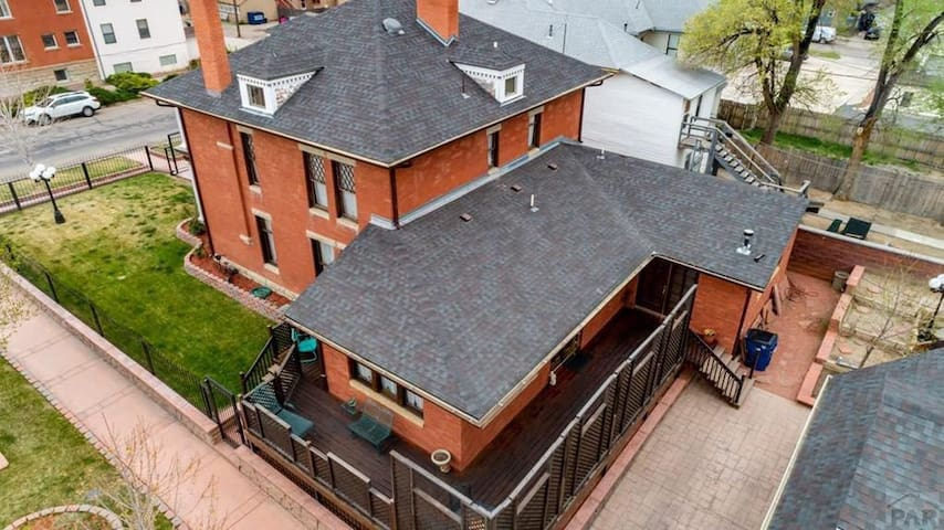 3 Story Colonial Brick Mansion with Private Executive Suite on the back. Cast Iron Gate surround the perimeter of the Mansion as well as multiple cameras and alarms making it more secure. ;-)