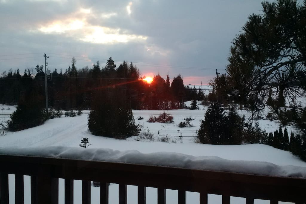 Winter sunset views, offering a private and spacious front lot.