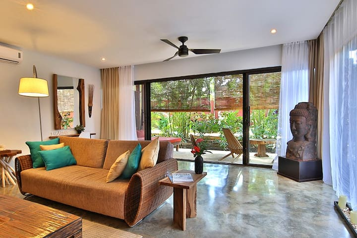 Your living room has plenty of space and attaches to the tropical gardens via your private balcony.