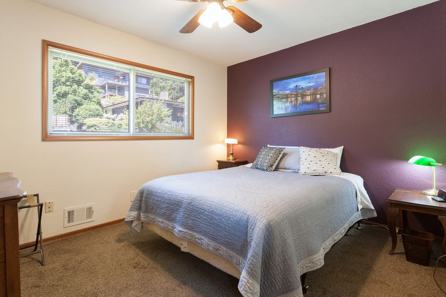 Your bedroom has loads of light!! And there is a SUPER comfy memory-foam topper on the bed.  Most guests say they REALLY sleep well on this bed.