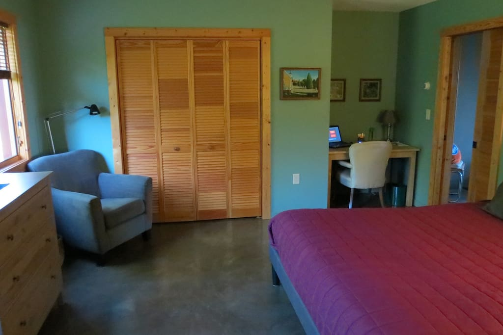 The spacious guestroom with king bed
