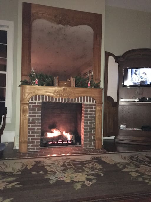Family/Living Room Beautiful French mantle and Trumeau mirror complete with gas logs for cozy Fall & Winter nights!