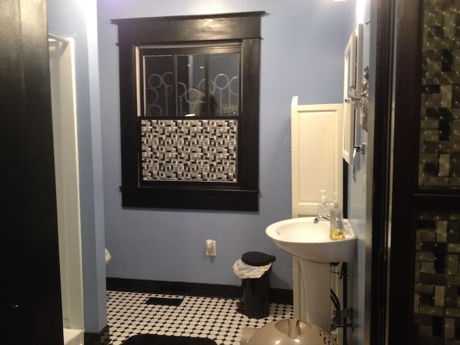 Beautiful retro bathroom with walk in shower.