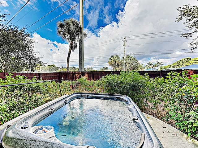 Enjoy a soak in your private hot tub.