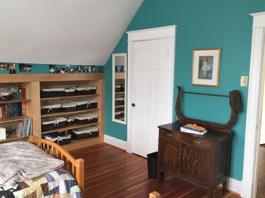 Built-in bookcases and antique wash stand in the lovely renovated west bedroom