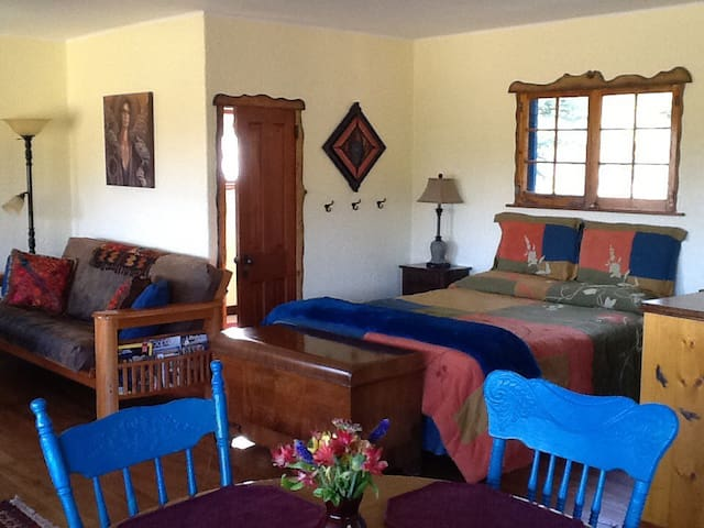 Inside Fiddlehead - bright and cheery with comfy queen bed right in the centre.