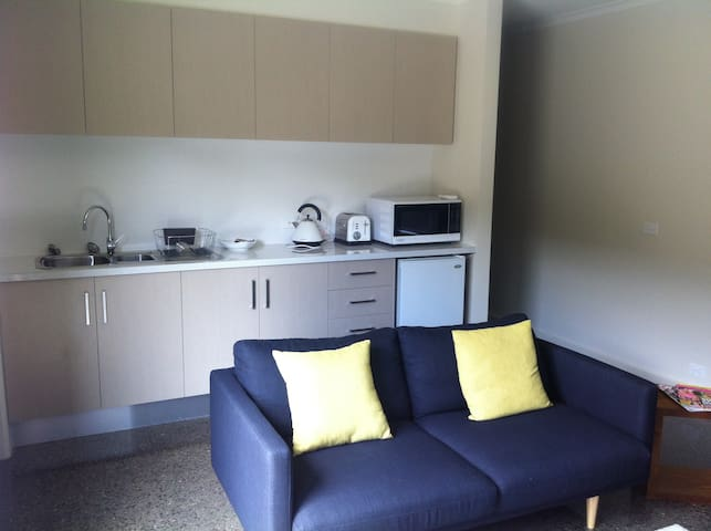 Separate lounge and dining area with kitchenette