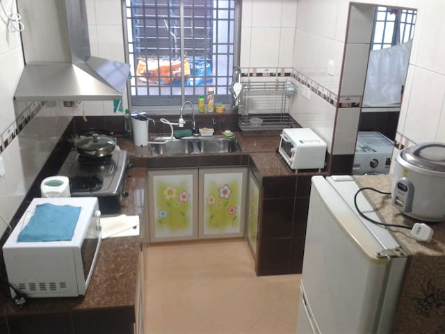 Kitchen equips with toaster, microwave, stove, refrigerator, water purifier and kettle.