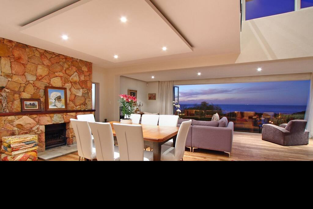 Open plan dining and lounge area with views and folding doors.