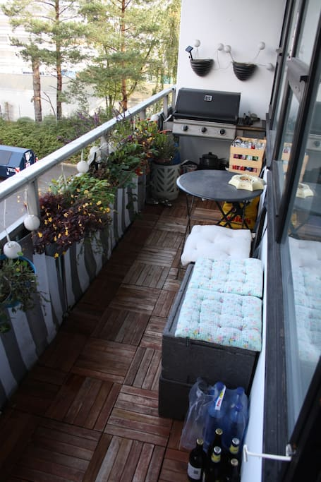 Big balcony with gas grill, small table with 2 chairs, lots of fresh herbs.
