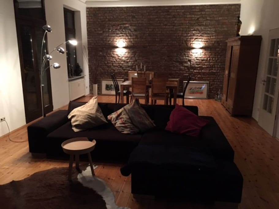 50m2 living room, brick wall, wooden floor, stucco