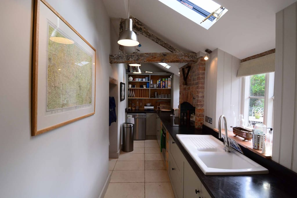 Gallery-style fulled fitted and equipped kitchen with plenty of work space.