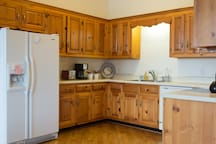 Fully equipped kitchen: fridge/freezer, stove w/ oven, microwave, dishwasher and plenty of cookware, coffee pot, blender etc.