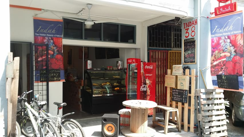 The front entrance of Indah when we 1st open in July '14. We serve  what we make & cook: cakes, pie, quiche, ice cream, nasi lemak (coconut fragrance rice) & Italian coffee.