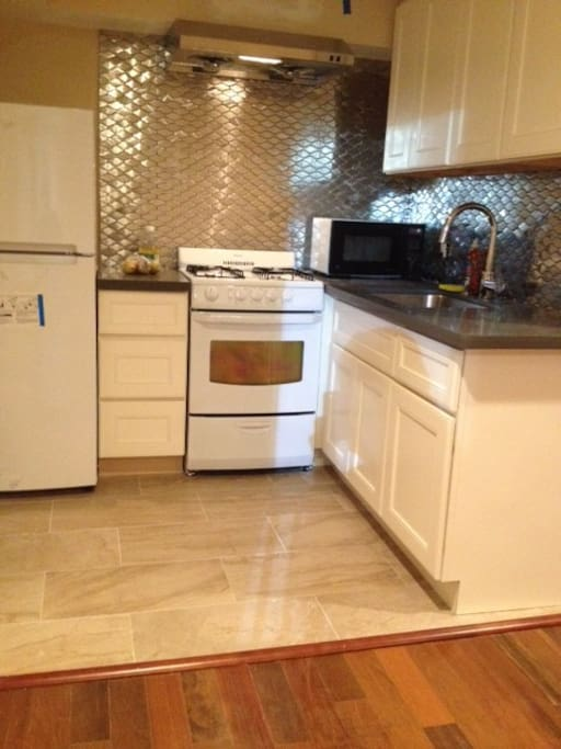 Full kitchen has gas range with oven, full size fridge.