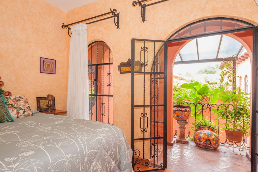 Hand-forged iron doors and drapery hardware, made in San Miguel