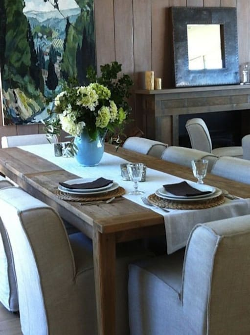 Dinning room with a view to the Pacific, beautiful cutlery and crockery, wood stove