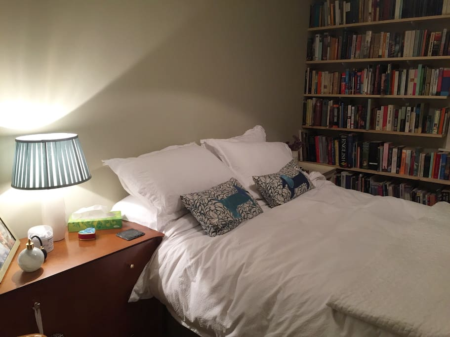 Double bedroom with plenty of reading material