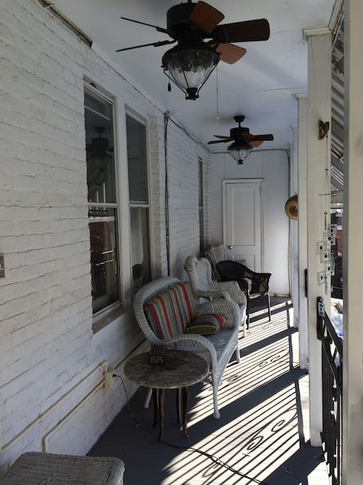 The apartment has a private porch with comfortable seating.  Access from the kitchen.