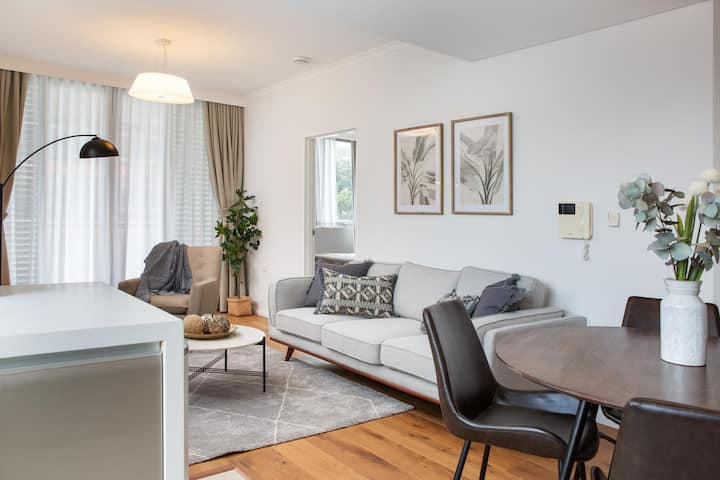Tidy Apartment with Balcony and Parking Near Trains