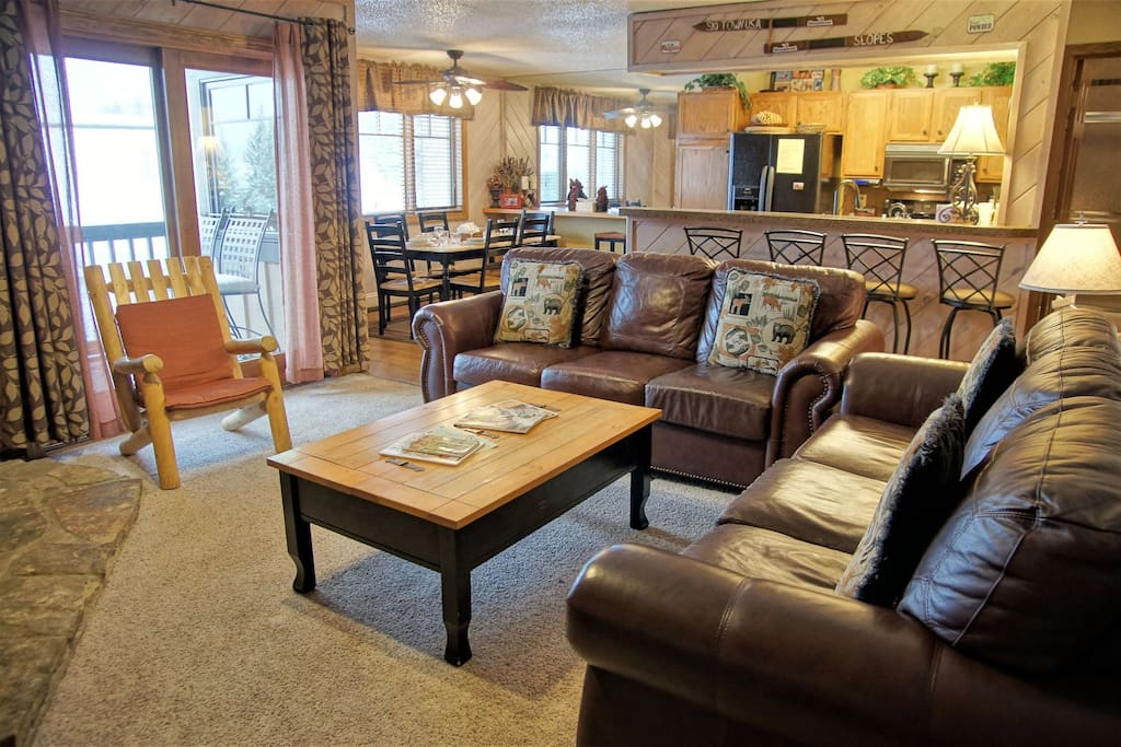 2 Leather Couches provide plenty of comfortable seating in the Living Room