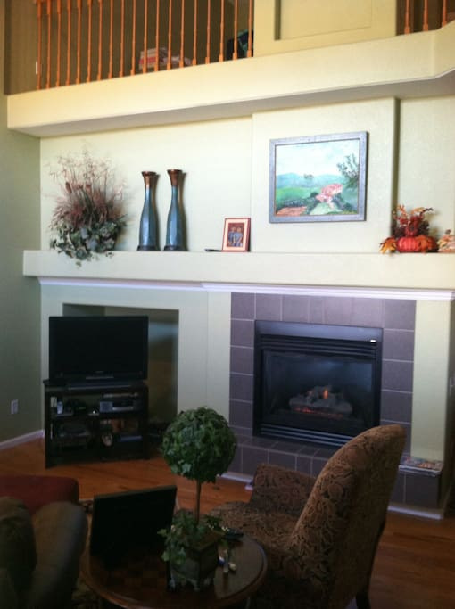 Cozy seating for everyone to enjoy the gas fireplace or watch TV.