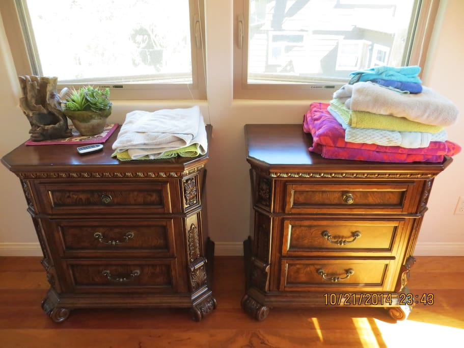 Bedroom has his and her drawer chests.