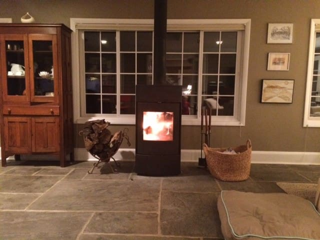 Woodburning stove in living / dining room.