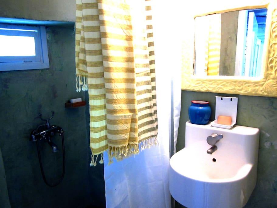 lavander room bath room comfortable and very functional.