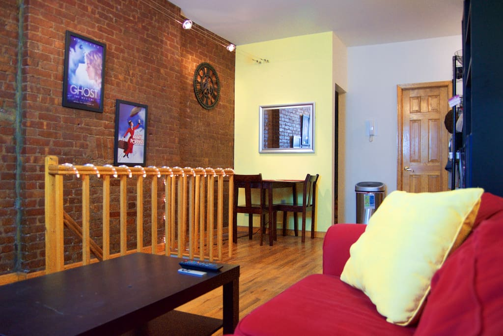 Living/Dining Area - Exposed brick wall, dining table for eating in and morning coffee.
